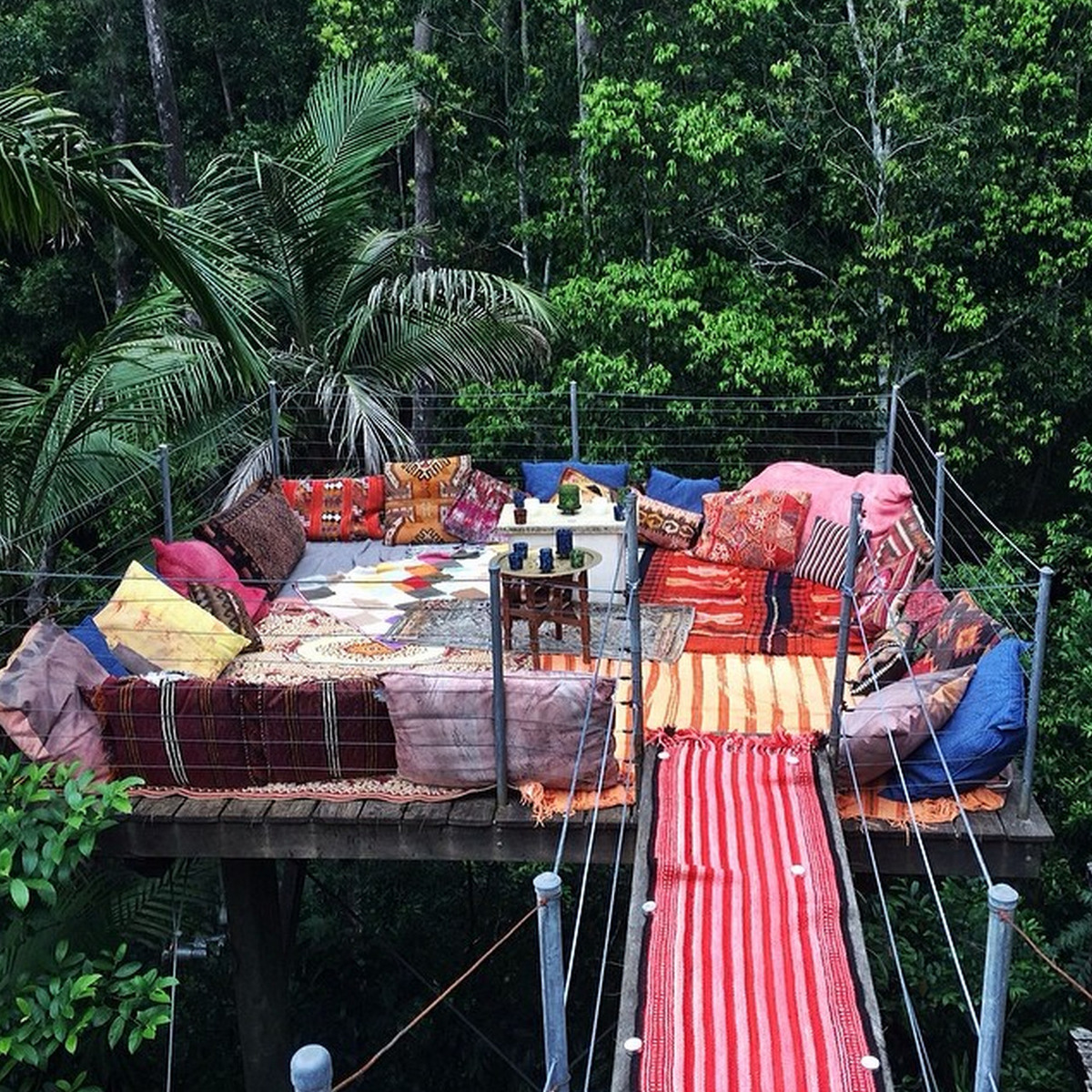 Bellingen treehouse accommodation in NSW filled with boho pillows and decor
