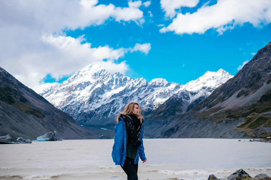 Solo female traveler at hooker valley new zealand