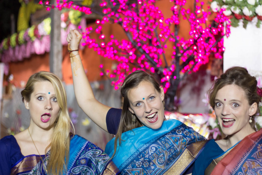 three girls at a wedding in India