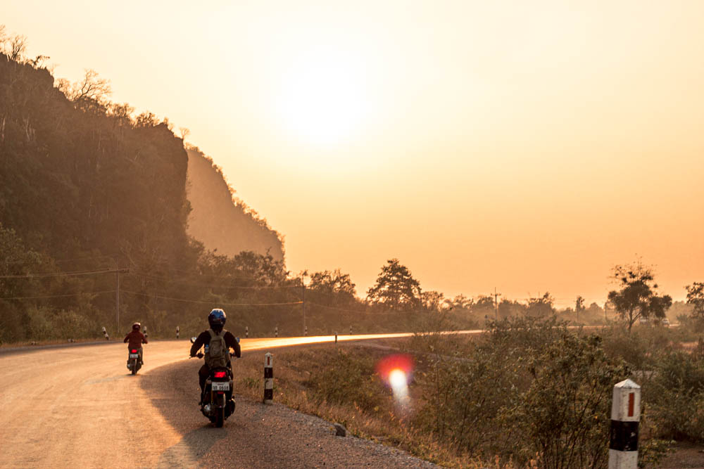 Sunset during the thakhek loop on a motorcycle