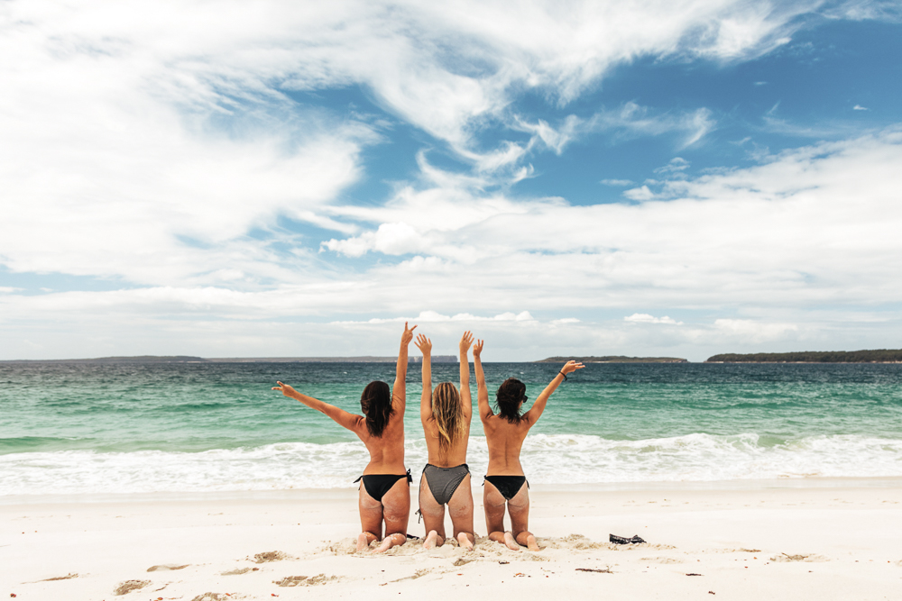 three girls in bikini on Jervis Bay Beach on a weekend getaway from Sydney