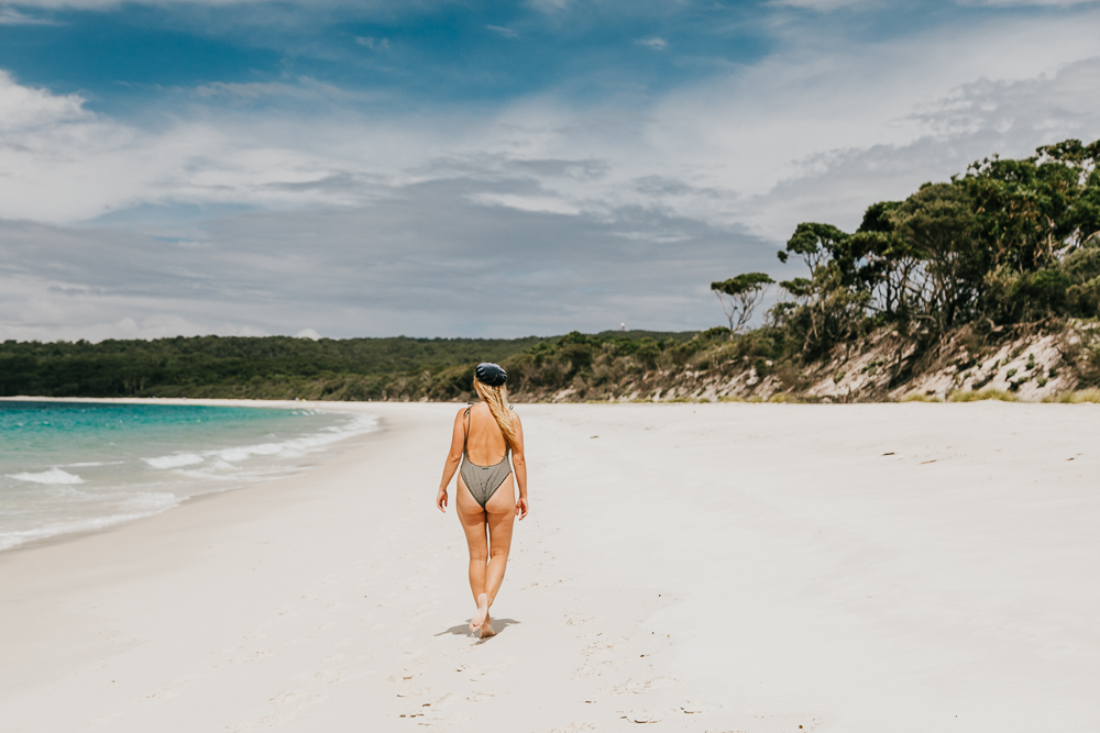 girl walking along Green Patch Beach in Jervis Bay, NSW